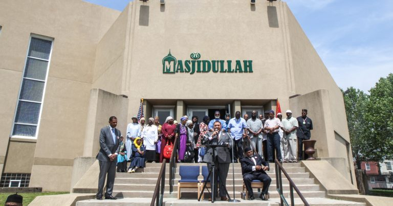 Leaders and members of the Masjidullah congregation gather to share a message of love Friday afternoon. (Kimberly Paynter/WHYY)