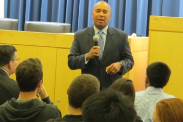 Massachusetts Gov. Deval Patrick talks with Princeton University students during a campaign stop in support of U.S. Senate candidate Cory Booker. (Phil Gregory/WHYY)