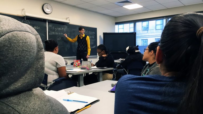 Gregory Fein teaches a CUNY Start math class at Borough of Manhattan Community College. (Karen Shakerdge/for WHYY)