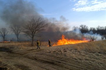 District wardens Kevin Morrissey, left, and Mike Moran, right, working during a prescribed burn at Monmouth Battlefield State Park on March 8, 2014. (Courtesy of Pete Monaco, NJFFS)