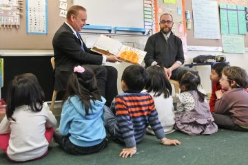 Democratic primary candidate for governor Rob McCord reads The Very Hungry Caterpillar to preschool students at the Children's Village Early Learning Center. (Kimberly Paynter/WHYY)
