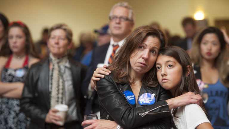 Heather Silvestri embraces her daughter Zoe Ferguson as they watch the disappointing election returns. (Jonathan Wilson for Newsworks)
