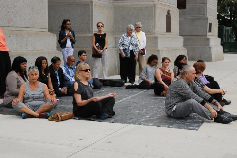 A meditation flash mob in Philly gathers to mark  Peace Day. (Tom MacDonald/WHYY)