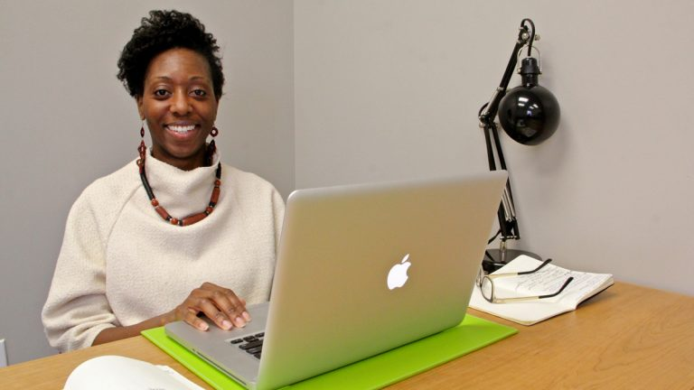 Consultant Melissa Howell makes use of a workspace at the Immigration Innovation Hub at Mt. Airy USA. (Emma Lee/WHYY)
