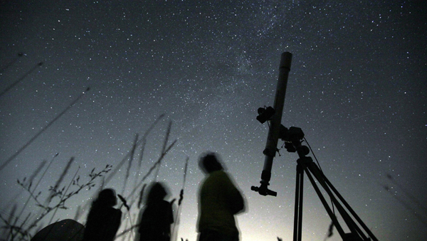 The annual Perseid meteor shower is promising to put on a dazzling sky show. Astronomers say up to 100 meteors per hour are expected to streak across the sky during the shower's peak. (Petar Petrov/AP Photo, file)