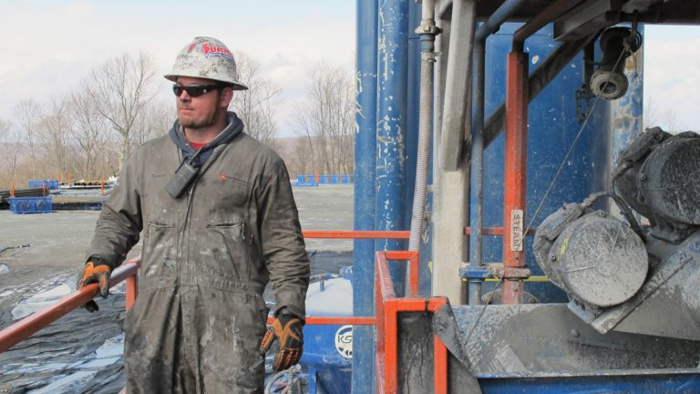 A worker stands by a natural gas well in Susquehanna County, Pennsylvania. (Susan Phillips/StateImpact Pennsylvania)