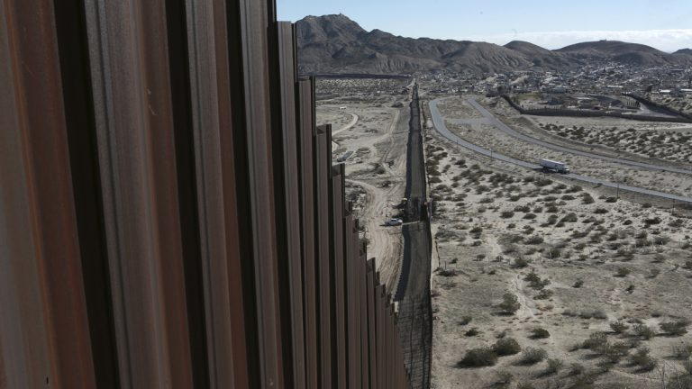 "A truck drives near the Mexico-U.S. border fence. Sens. John McCain and Chris. Coons formally introduced a bill that would grant permanent legal status to undocumented immigrants known as ""Dreamers,"" and start bolstering security along the U.S.-Mexico border. (AP file photo)"