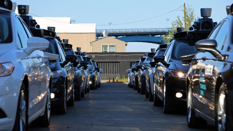 Uber's self-driving cars wait at the company's Advanced Technologies Center in Pittsburgh on Sept. 13