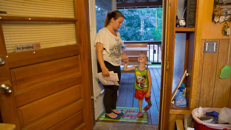 "Michelle Andrews helps her son, Gabriel, into the house after playing in the backyard. She is one of three women Keystone Crossroads' reporter Marielle Segarra followed for the story, ""At Allentown's Turner Street program, insight into what homeless families need."" Listen here: http://bit.ly/2dRsU4A (Lindsay Lazarski/WHYY)"