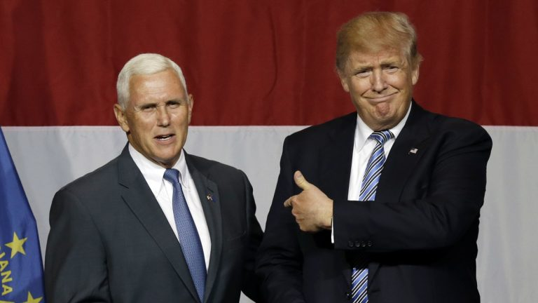 Indiana Gov. Mike Pence is shown with Republican presidential candidate Donald Trump at a rally in Westfield