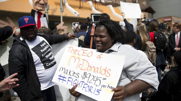 Fast food worker Lateefa Davis gathers with others for a May Day demonstration calling for a raise of the minimum wages to $15 an hour Friday, May 1, 2015, at a McDonald's restaurant in Philadelphia, Pa. (AP Photo/Matt Rourke)