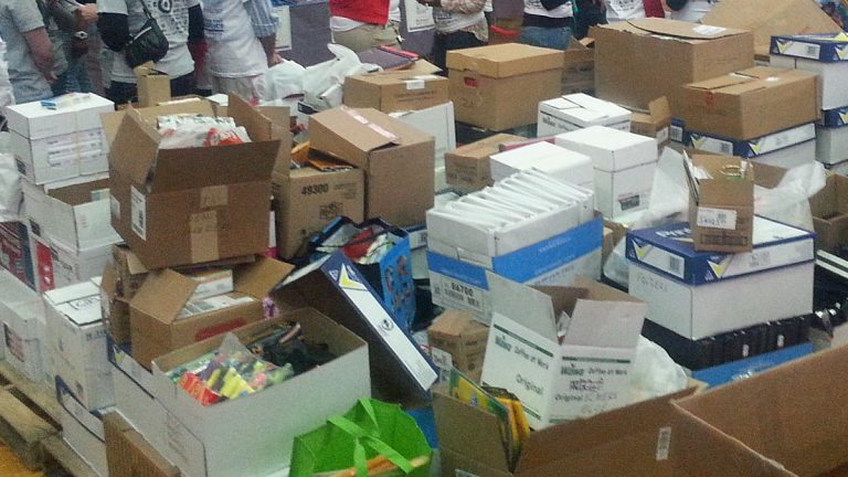 Donated school supplies pile up inside Girard College at an MLK Day of Service event. (Tom MacDonald/WHYY)