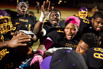 The MLK High Cougars football team celebrates its win over Franklin. (Brad Larrison/for NewsWorks)
