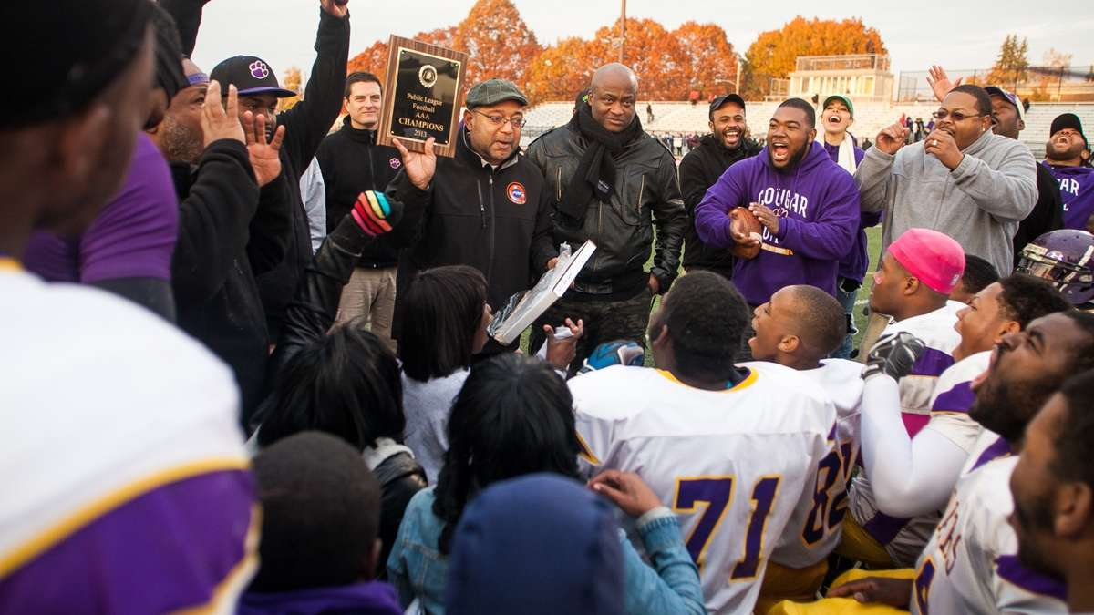 After winning the title game 32-7 on Saturday afternoon, the MLK High Cougars football players get their first look at the Public League AAA Championship plaque. Check back Monday for a recap of tomorrow's playoff game. (Brad Larrison/for NewsWorks)