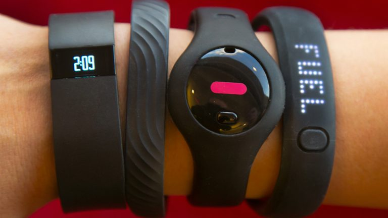 Four fitness trackers from left to right
