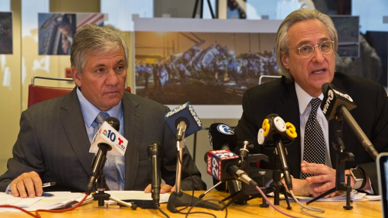 Attorneys Robert J. Mongeluzzi (left) and Tom Kline,  represent 29 of the more than 200 passengers injured and killed in the Amtrak derailment in North Philadelphia last May. All 188 cases filed have been consolidated in U.S. District Court in Philadelphia. (Kimberly Paynter/WHYY)