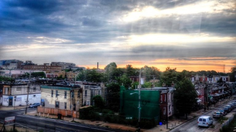 Morning sunrise over North Philly seen from the Chestnut Hill West Regional Rail line. (Courtesy of Sheppard Williams)