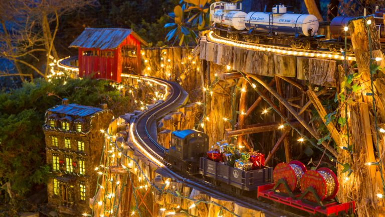 Morris Arboretum's popular Holiday Garden Railway returns with model trains in action, decorated for the holidays with thousands of twinkling lights on an outdoor quarter-mile track. Photo by Mark Stehle.