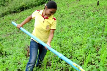 Sawika ìDenî Jaiping, a subsistence farmer in Bo Kluea, Thailand, tries the weeder co-developed by a Drexel University professor. (Photo courtesy of Alexander Moseson)