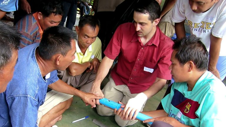 A group of self-taught mechanics in remote Bo Kluea, Thailand, brainstorm design improvements for a labor-saving seed planter with Drexel University's Alexander Moseson. (Image courtesy of Drexel University)