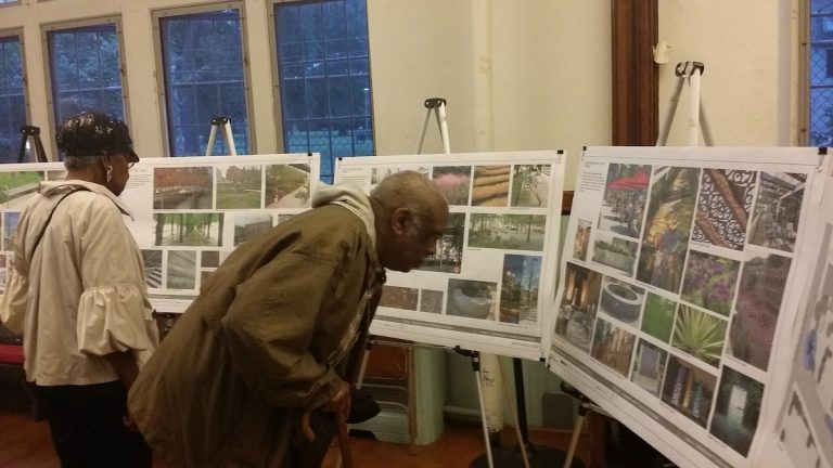 Residents check out the design proposals for the looming Maplewood Mall revamp project. (Queen Muse/for NewsWorks)