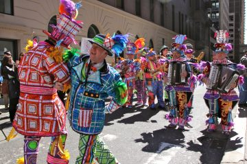 The Mummers are back to ring in the year 2017.  Pictured: Mummers Shawn Slivinski and Mike Doyle dance as the Joseph A. Ferko String Band plays outside 1518 Walnut St.