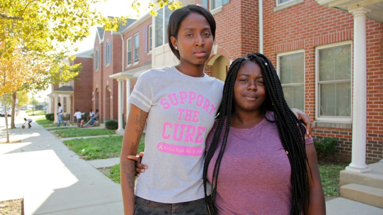 The sister and cousin of transgender murder victim Kiesha Jenkins, Ronnia Jenkins (left) and Sade Skelton, meet on Morris Avenue in South Philadelphia, where Jenkins lived. (Emma Lee/WHYY)