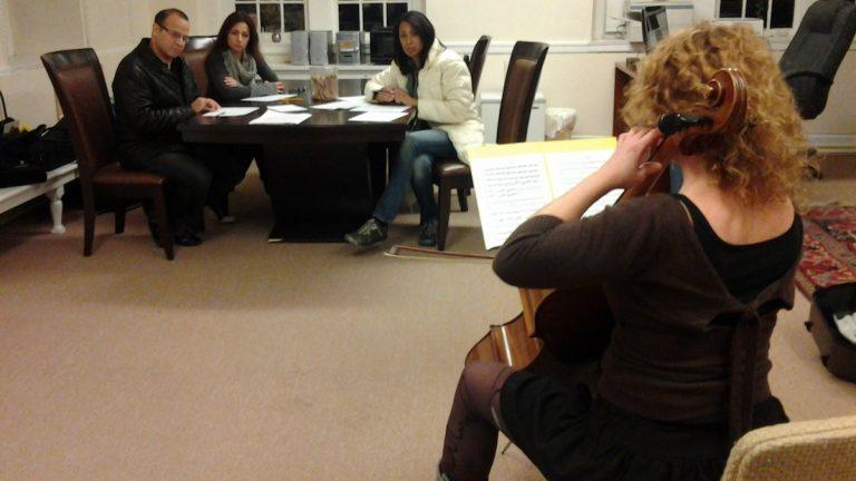 Music Director Jeri Lynne Johnson, in white, listens to Marthelène Gabon. (Alaina Mabaso/for NewsWorks)
