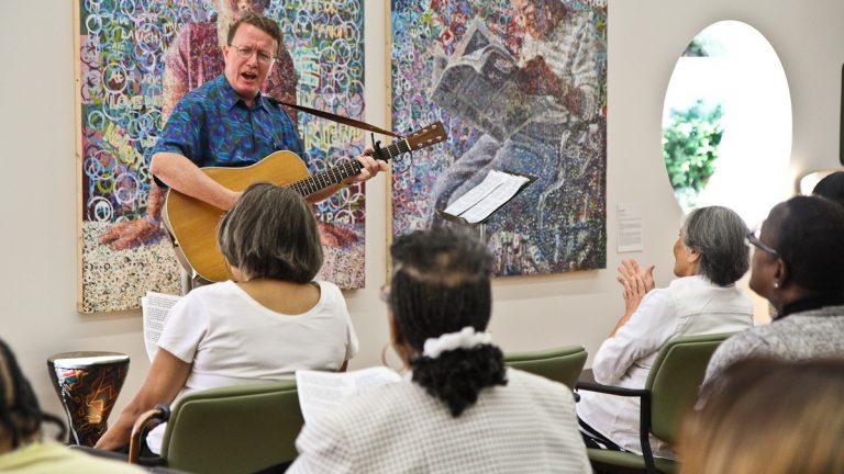 Jerry O'Leary leads a musc therapy class in a song at NewCourtland LIFE in North Philadelphia. (Kimberly Paynter/WHYY)