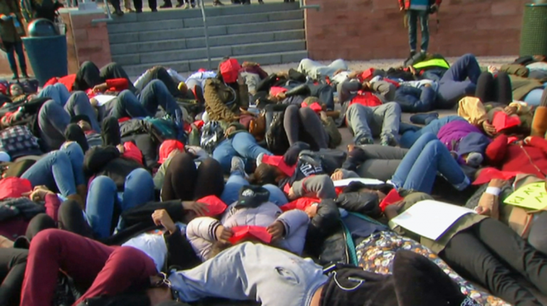 Temple University students lay down in protest Thursday afternoon as a demonstration against racism (Image courtesy of NBC10)