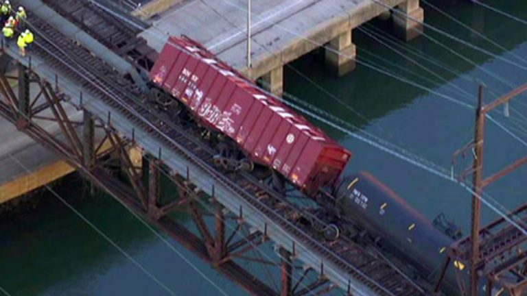 Seven cars of a CSX freight train derailed on a bridge that spans the Schuylkill River and I-76. Six carried crude oil and another is carried sand. (NBC10 Photo)