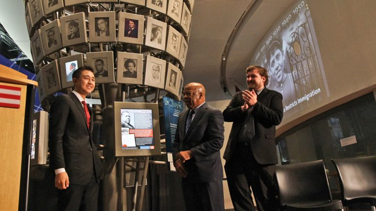 Congressman John Lewis and essay winner Sam Duffy unveil a new edition to the National Constitution Center's National Tree Exhibit, first African American Senator Hiram Rhodes Revels. (Kimberly Paynter/WHYY)
