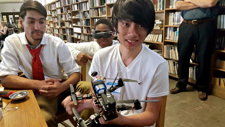 Hoang Bui, 20, shows off his quad-copter during a