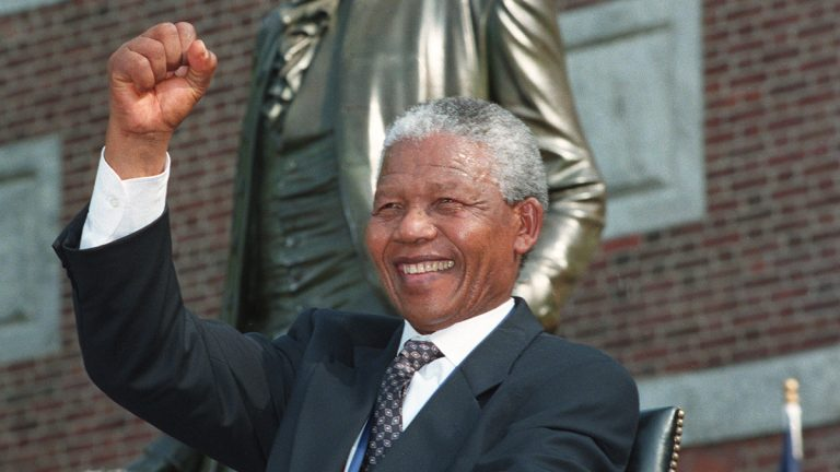 Nelson Mandela is shown seated in front of Independence Hall on July 4, 1993, in Philadelphia, where he was later presented with the Liberty Medal by President Bill Clinton. (AP Photo/J. Scott Applewhite)