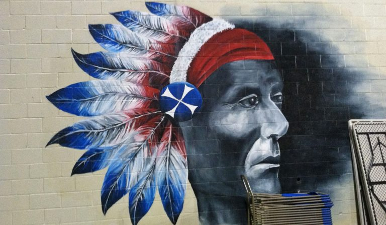 A mural of the Neshaminy High School mascot, the Redskin.  (Eugene Sonn/WHYY)