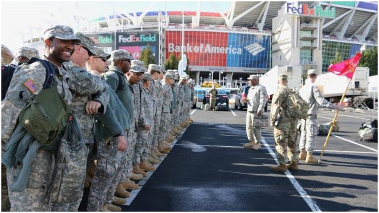 Soldiers with the Delaware Army National Guard's 262nd Component Repair Company appear outside of FedEx Field in Landover