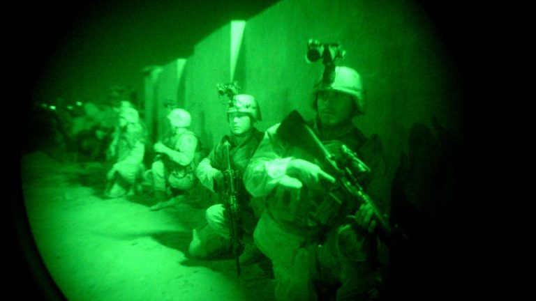 US soldiers are seen  through a night vision scope in Iraq. (AP Photo/Rob Griffith)