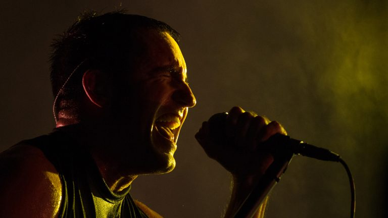 Trent Reznor, lead singer of the band Nine Inch Nails performs at the Lollapalooza Festival in Chicago, Friday, Aug. 2, 2013. The more than two-decade-old festival opens Friday in Chicago's lakefront Grant Park. (AP Photo/Scott Eisen)