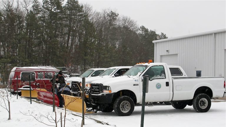 Brick Township, N.J., Public Works employees check snow removal equipment as a winter storm bears down on the state. (Phil Gregory/WHYY)