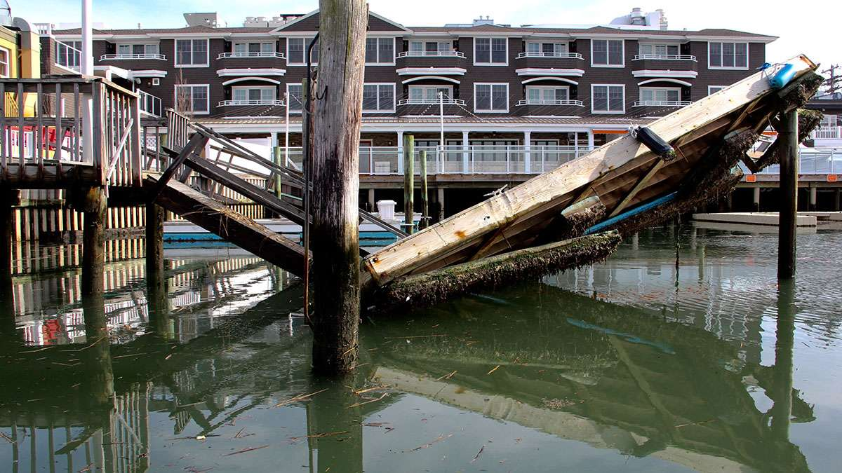 The violence of the storm is reflected in the now glassy water of the back bay in Stone Harbor. (Emma Lee/WHYY)
