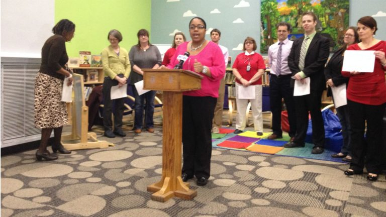 Warner Elementary School teacher Equetta Jones (center) speaks to the media. (Avi Wolfman-Arent, WHYY)