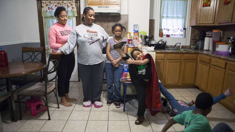 Christina Moffett lives in a five-bedroom apartment on the second and third floors of a multi-unit building with five of her six children and a baby on the way on North Washington Avenue in Scranton, Pa. (Photography by Jessica Kourkounis)