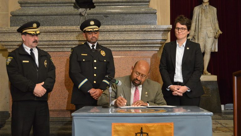 Mayor Michael Nutter signing the executive order banning sexual assaults in Philadelphia prisons (Tom MacDonald/WHYY)