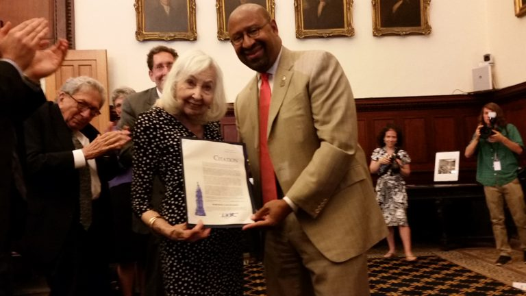 Marciene Mattleman and Mayor Michael Nutter display the city proclamation in her honor Wednesday. (Tom MacDonald/WHYY)