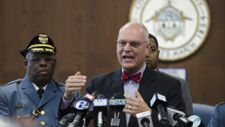 Atlantic City Police Chief Henry White looks on as Atlantic City Mayor Don Guardian talks about the city shutdown during a press conference held at Atlantic City