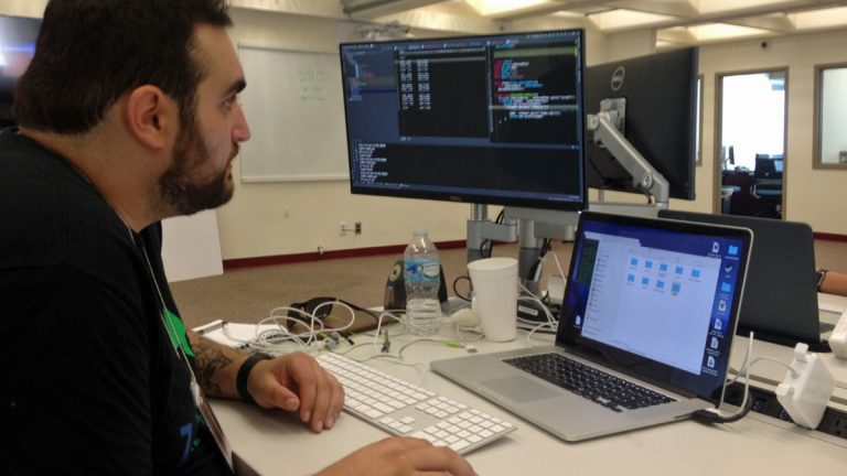 Sean Strauss tackles a coding challenge as part of the 90-day Zip Code Wilmington boot camp. (Avi Wolfman-Arent/WHYY)