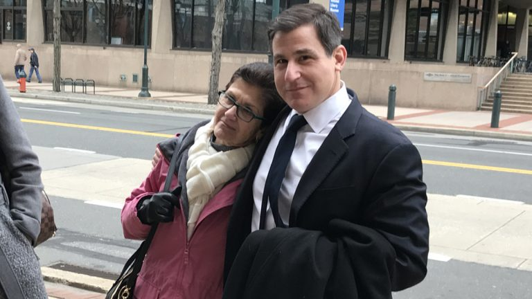 Senator Larry Farnese smiles with his mother outside the Federal Courthouse in Philadelphia after an acquittal  exonerating him of charges (Bobby Allyn/WHYY)