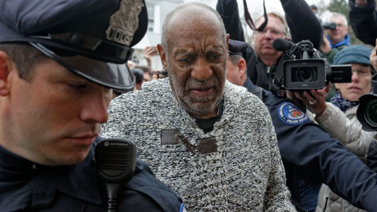 Bill Cosby wends through a crowd to District Court in Elkins Park, Pennsylvania, where he was required to post bail and surrender his passport after being charged with sexual assault. (Bastiaan Slabbers/for NewsWorks)