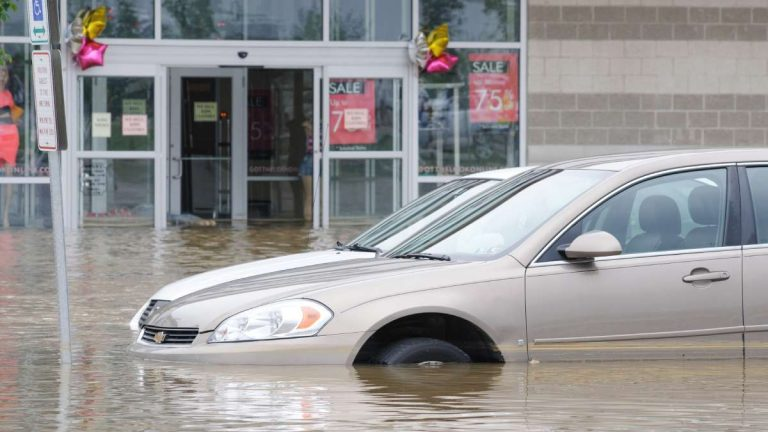Multiple cars in the Bakers Centre parking lot were partially submerged following the  June 18 water main break in East Falls. (Bastiaan Slabbers/for NewsWorks)