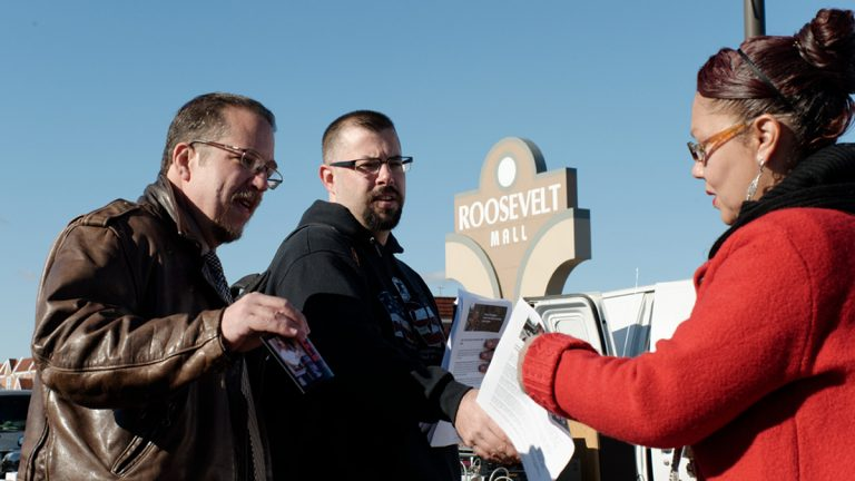 Ross Feinberg (left) Republican running for Register of Wills; and Chris Sawyer (center) the Republican candidate running for Philadelphia sheriff canvas together at the flea market outside Roosevelt Mall in Northeast Philadelphia (Bastiaan Slabbers/for NewsWorks)
